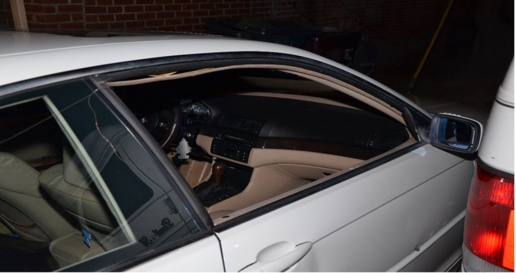 Daniels' BMW recovered on the 500 block of East 9th Street. A single bullet hole can be seen in the lower portion of the door.