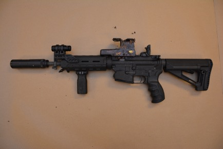 Del-Ton Inc DT Sport Semi-automatic rifle 5.56 caliber S/N DTI-S061620 with fake suppressor mounted to weapon, found with Francis