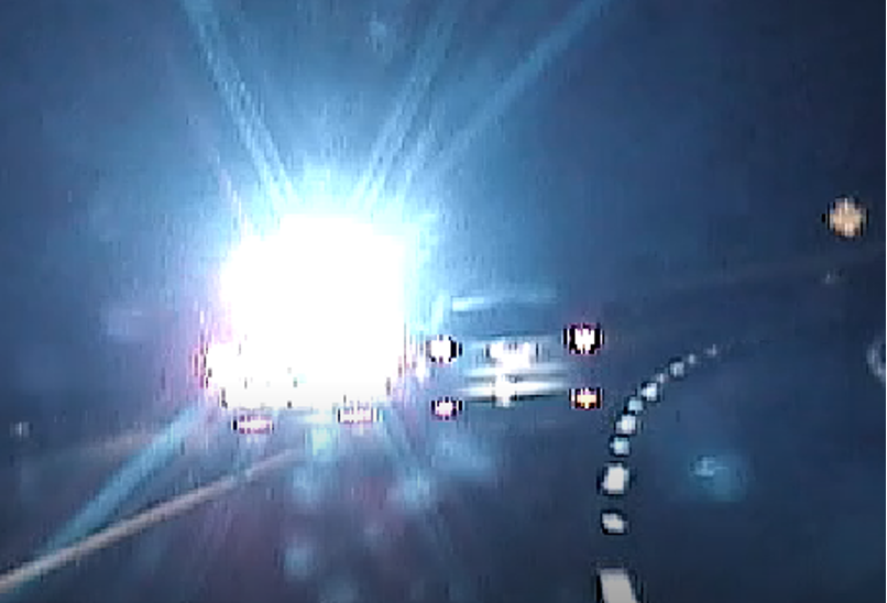 Screenshot from the PSP dashcam footage, showing the stolen Ford Escape on the right and the PSP lead vehicle on the left, being pushed into the median.