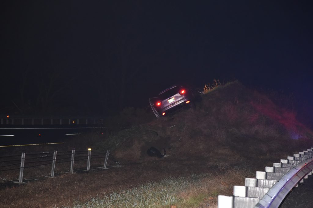 Stolen vehicle in the berm in the median on I-95.
